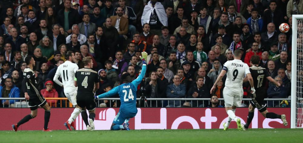 Real Madrid's Gareth Bale shoots against the post.