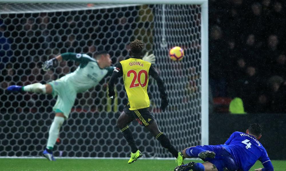 Domingos Quina steers the ball past Neil Etheridge for Watford's third goal.