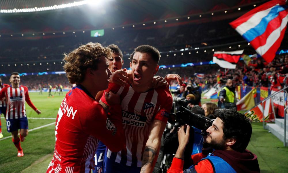 Atletico Madrid's Jose Gimenez celebrates scoring their first goal with teammates.