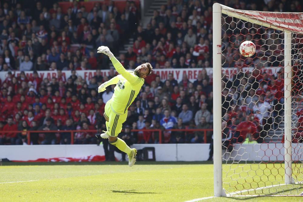 Ipswich Town's Bartosz Bialkowski is beaten by Forest's Chris Cohen shot for the second.