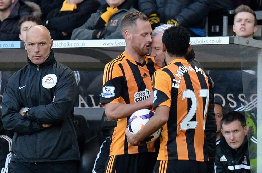 Hull City's David Meyler is headbutted by Alan Pardew on 1 March 2014