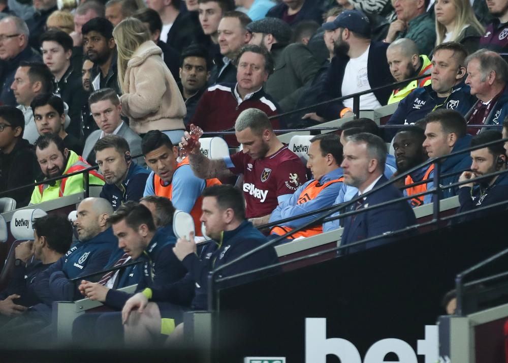 West Ham's Marko Arnautovic throws a bottle onto the ground in anger after being substituted for Grady Diangana.