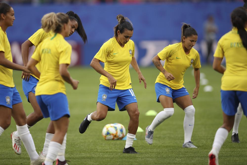 Brazil's Marta warms up with her teammates before the match in Valenciennes.