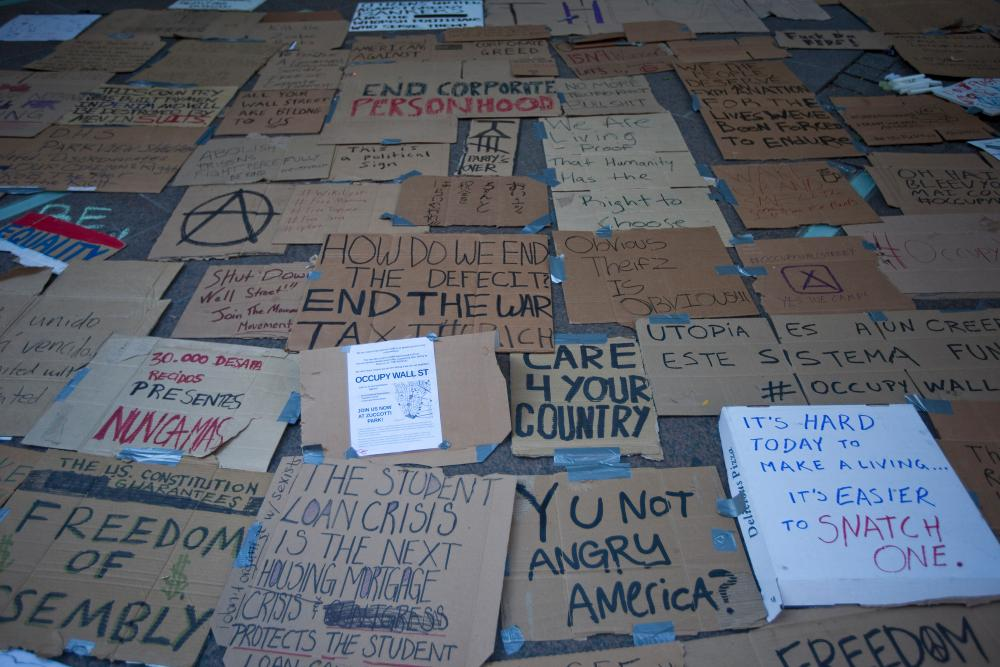 Signs on the floor in Zuccotti Park.