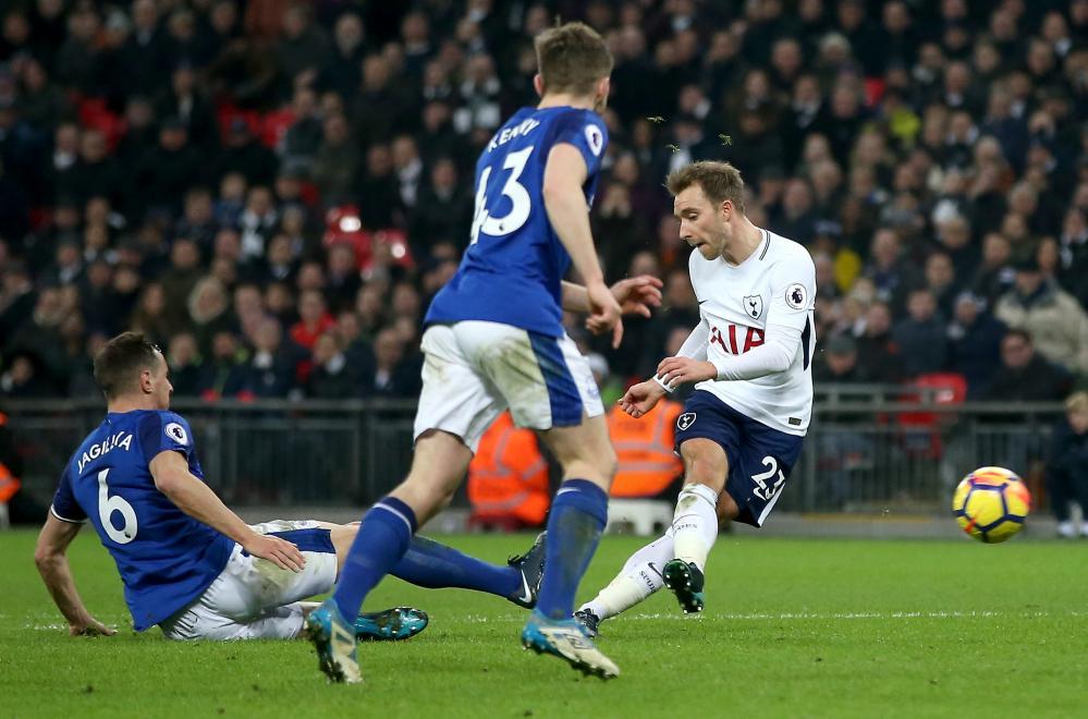 Christian Eriksen of Tottenham Hotspur scores his sides fourth goal.