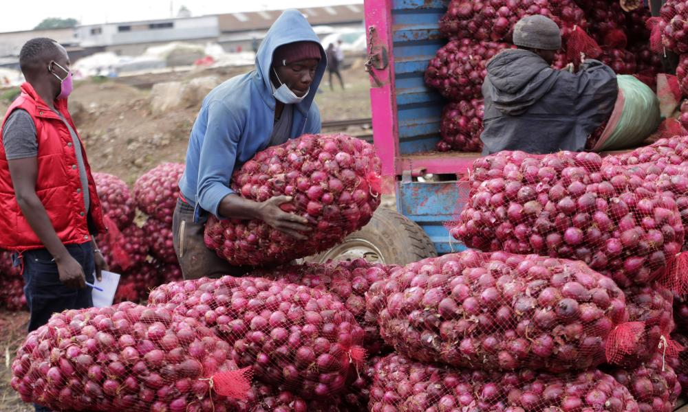 Onion traders at Wakulima fresh produce market in Kenya.