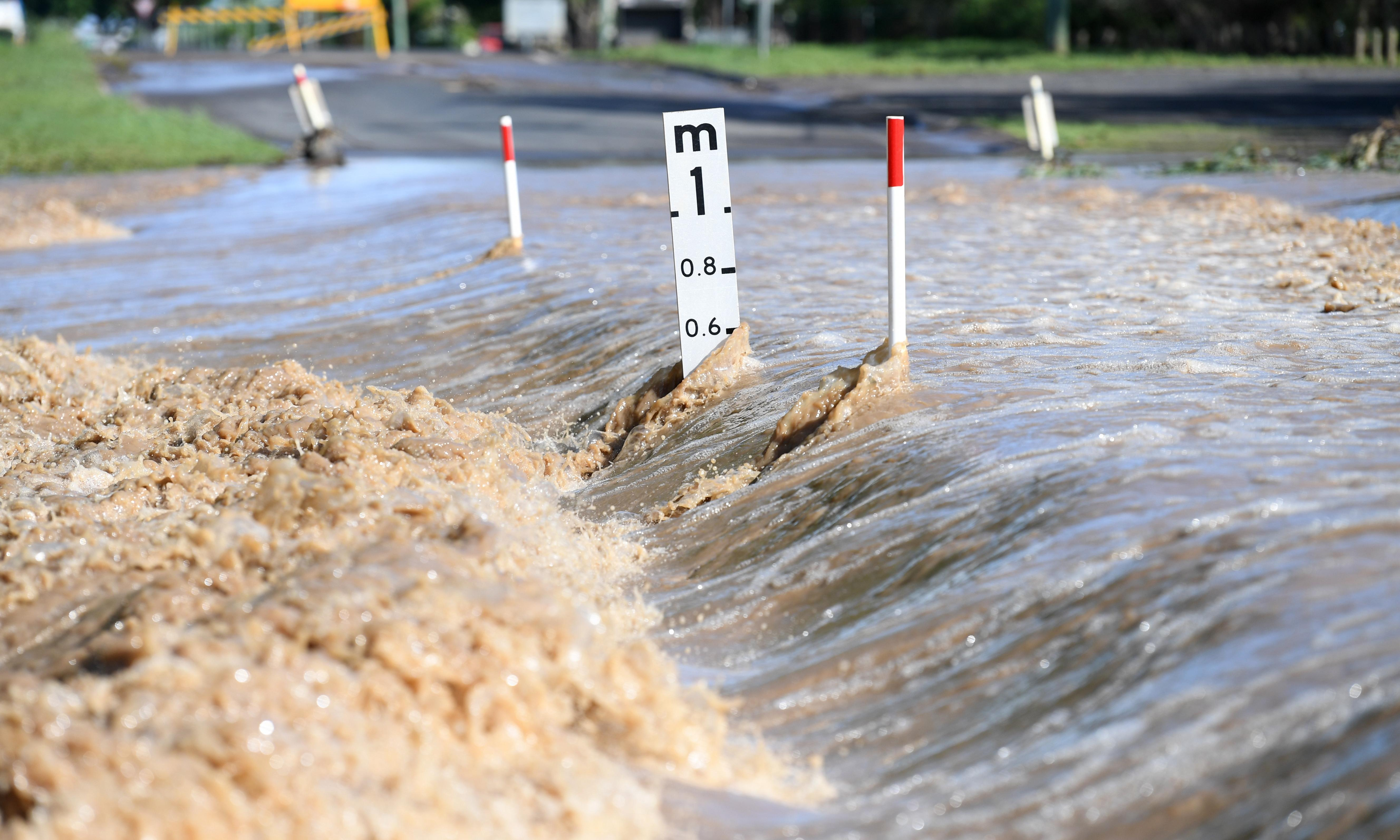 South-west Queensland towns brace for flooding as police declare emergency