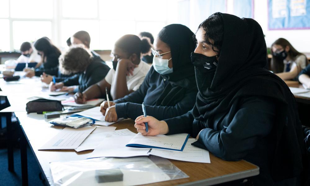 Masked children in class