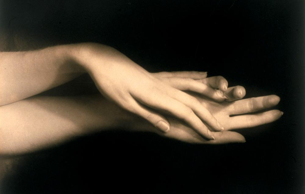 Artistic shot of hands intertwined