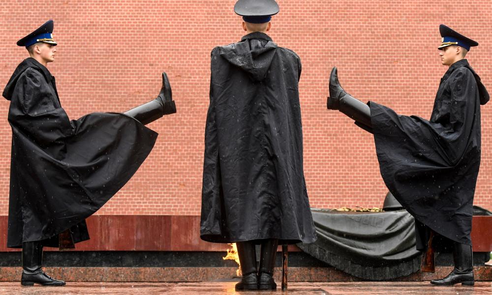 Russian honour guards stand on duty under the heavy rain at the Tomb of the Unknown Soldier by the Kremlin wall in downtown Moscow on 31 May 2020, during a strict lockdown in Russia to stop the spread of the Covid-19, (the novel coronavirus).