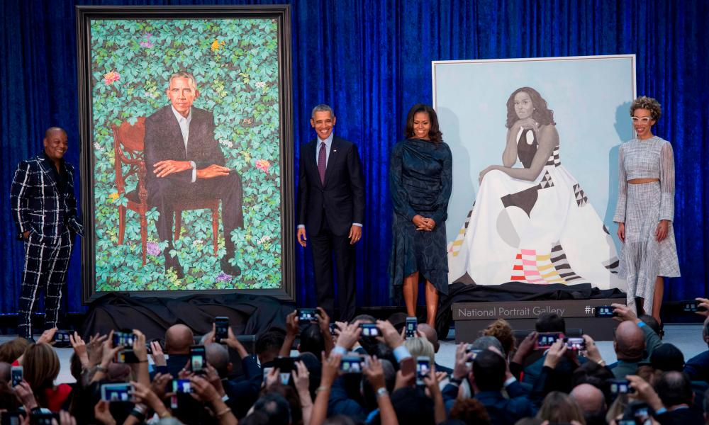Portraits of former president Barack Obama (by Kehinde Wiley) and former first lady Michelle Obama (by Amy Sherald)