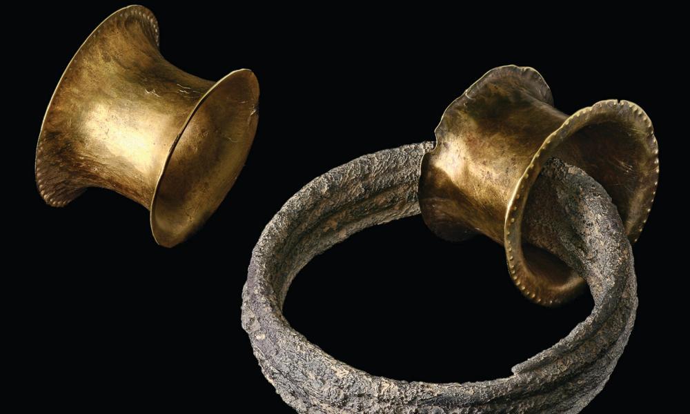 A bronze age ear plug and spiral found at La Almoloya in Murcia.
