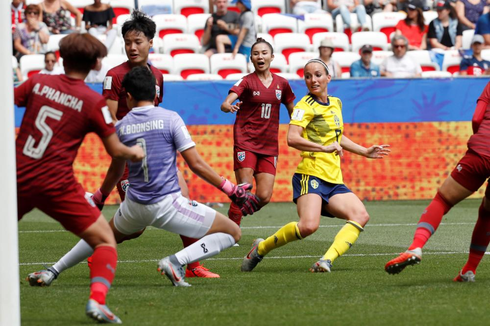 Sweden's Kosovare Asllani scores their second goal.