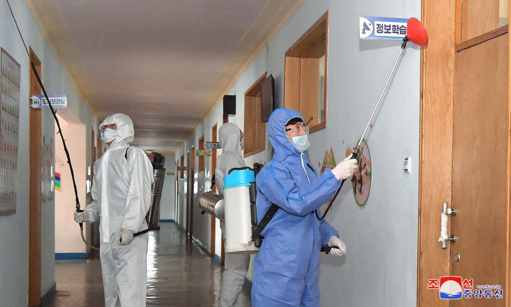 Sanitary and quarantine station personnel disinfect school facilities in Pyongyang, North Korea area to prevent the spread of coronavirus.
