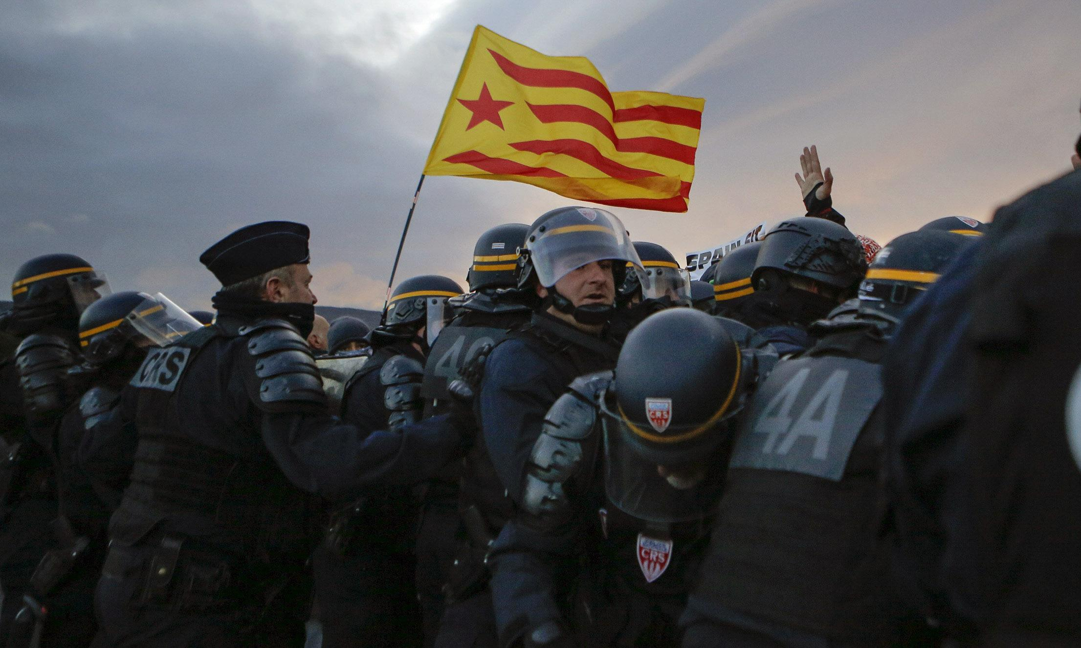 French police clear Catalan independence protesters from road