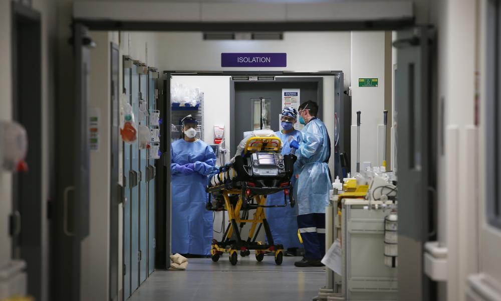 Doctors and nurses transport a patient