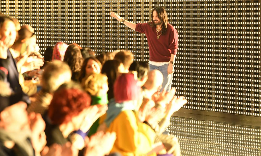 Alessandro Michele takes applause after the show