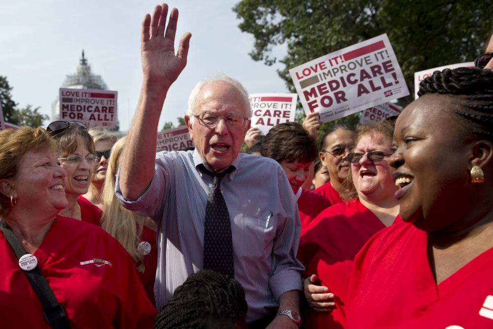 Bernie Sanders waves after speaking at a rally with registered nurses.