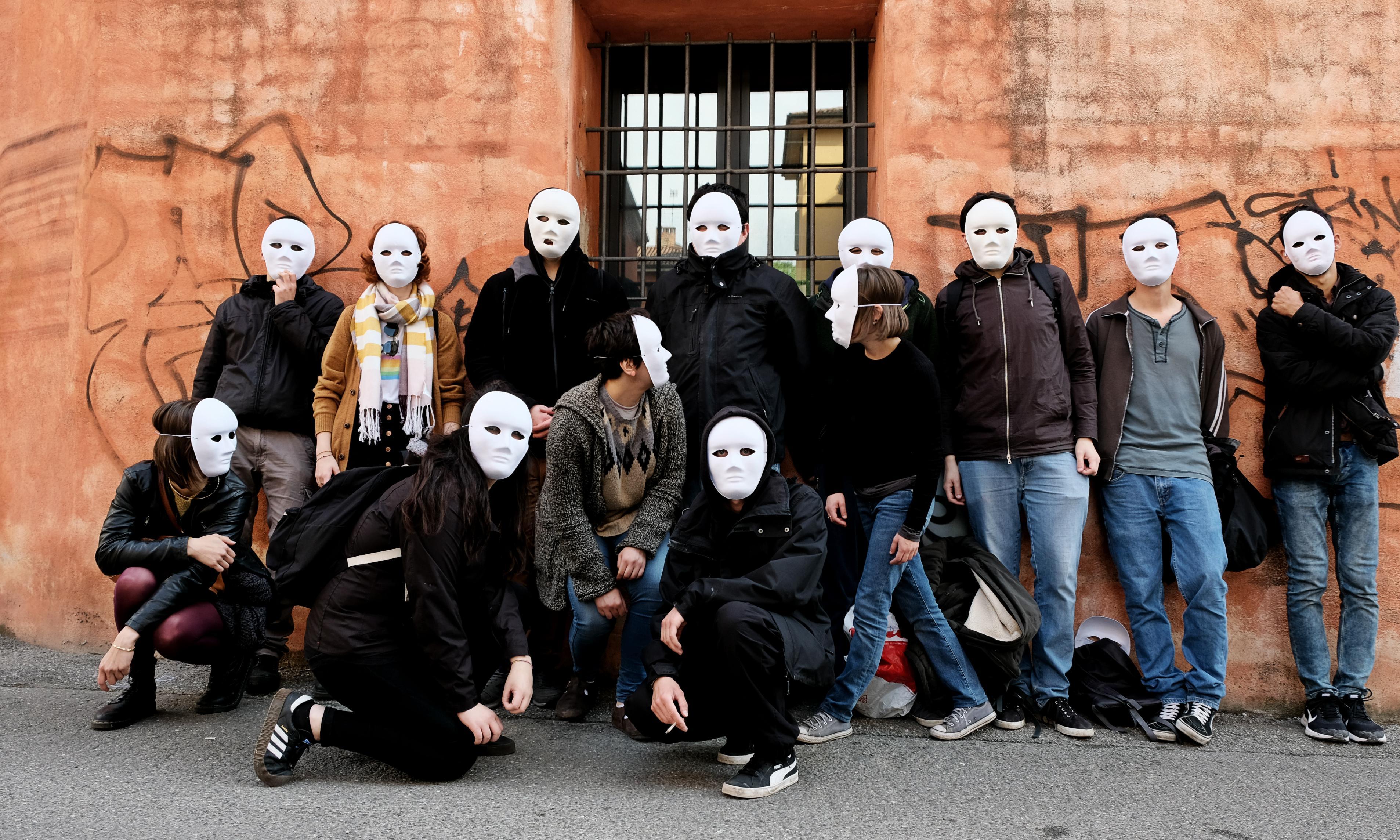 Horrible bosses: masked activists publicly shame businesses in Bologna