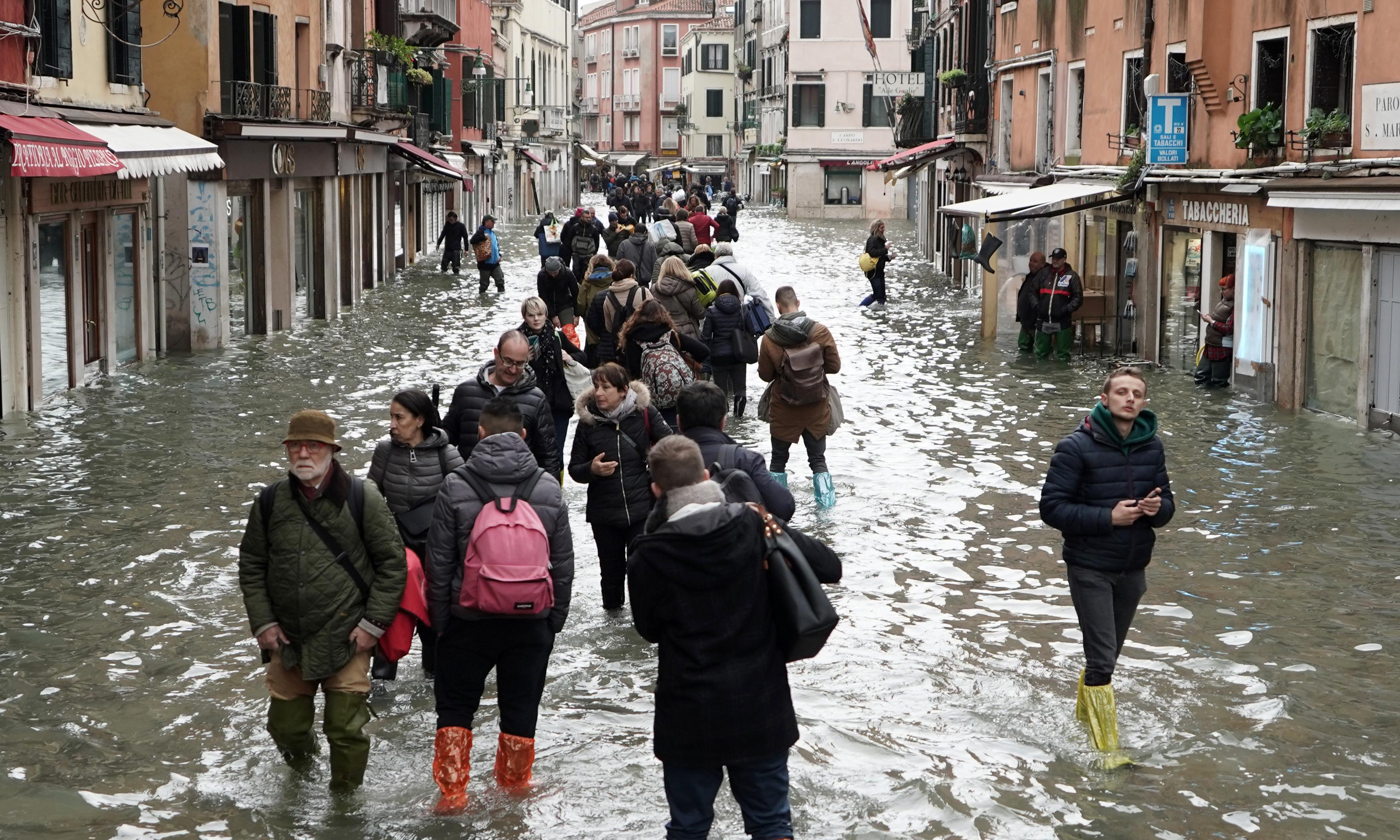 Venetians call for help as 'pride of Italy' deals with flood damage