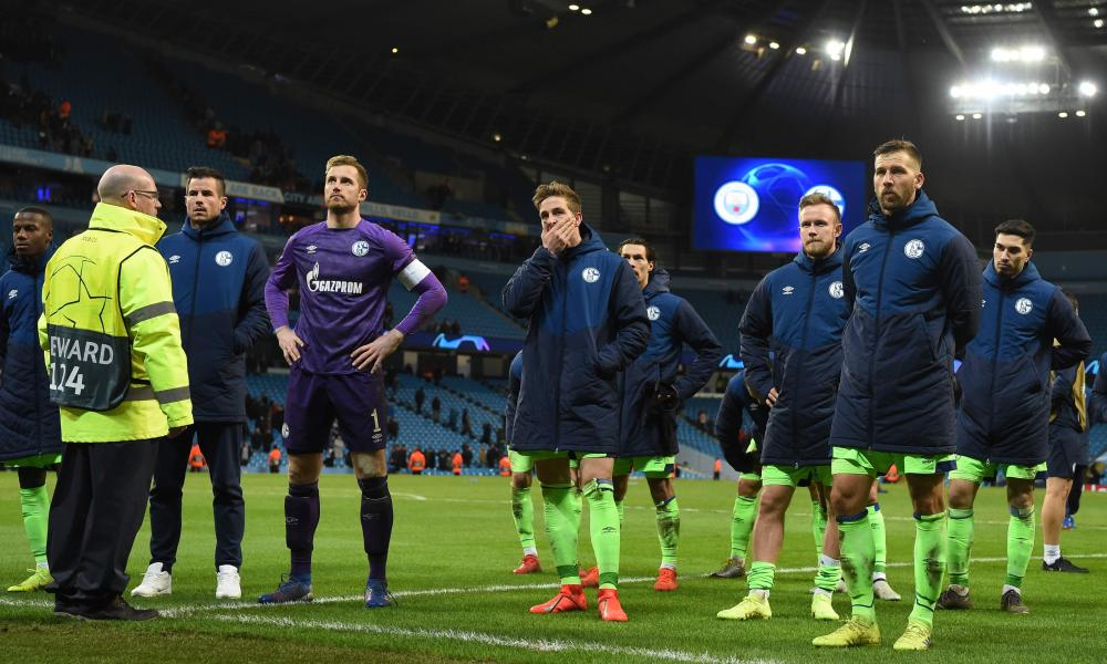 The Schalke players look shell-shocked as they go over to their fans after their drubbing.