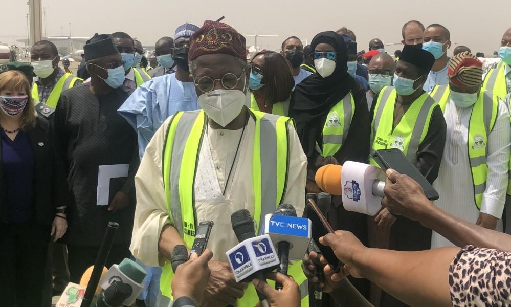 Minister of Information and Culture of Nigeria, Lai Mohammed (C) makes statements to media at the delivery ceremony for first badge of AstraZeneca/Oxford coronavirus vaccines, provided by Covax.