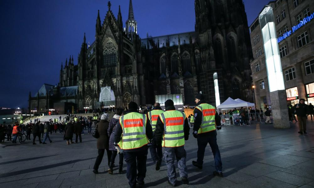 Security guards and extra police patrol the central square in Cologne a year on from the mass sexual assaults on women in the western German city.
