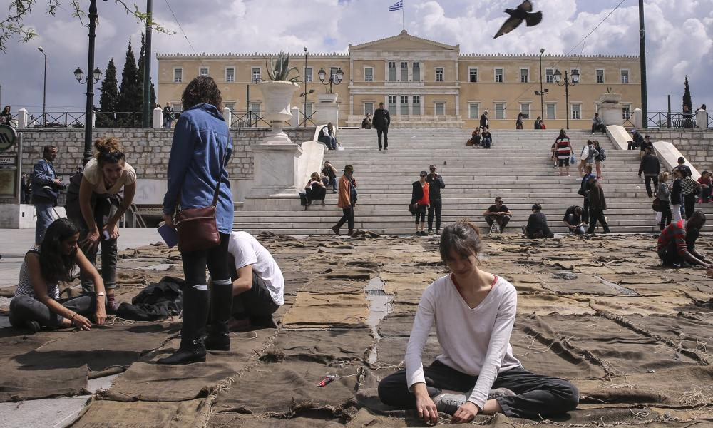 Ibrahim Mahama's performance piece Check Point: Prosfygika, in the central square of Athens.