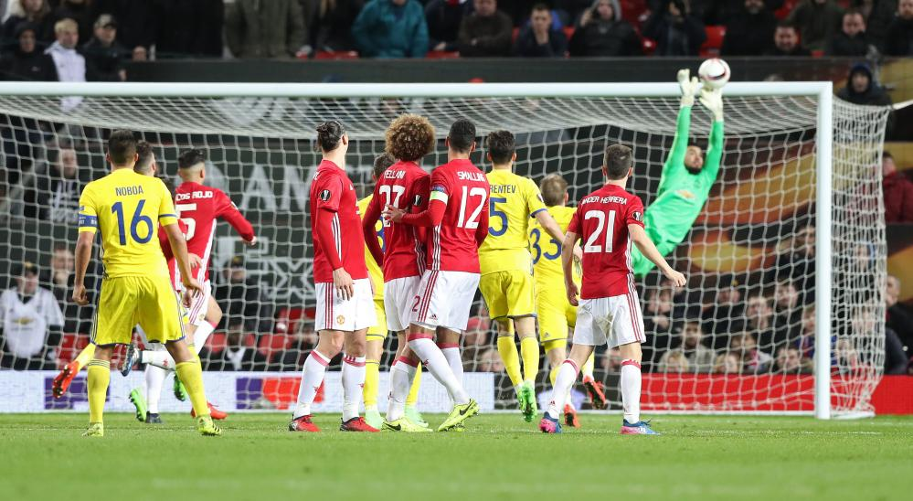 Rostov's Cristian Noboa  takes a free-kick which is saved by Manchester United goalkeeper Sergio Romero late in the game