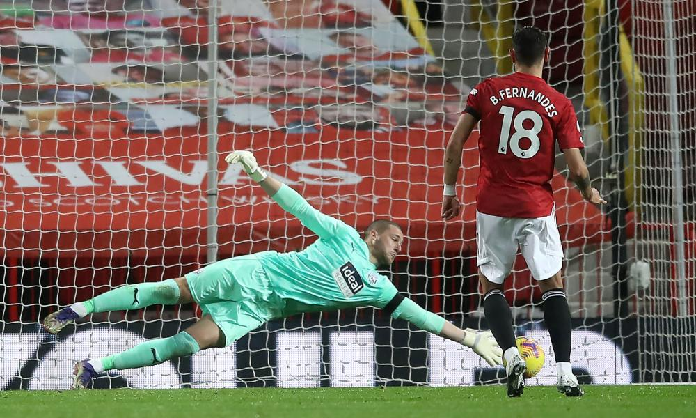 West Bromwich Albion goalkeeper Sam Johnstone saves the first penalty attempt from Manchester United's Bruno Fernandes.