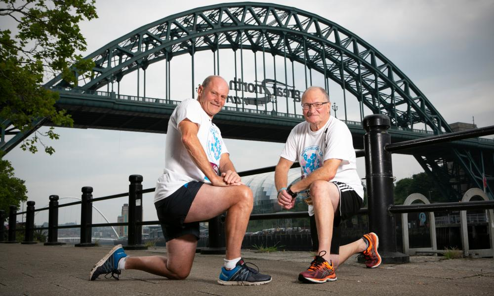 Bob Hepburn, left, and Ron Snaith pose in their running gear in the shadow of the Tyne Bridge
