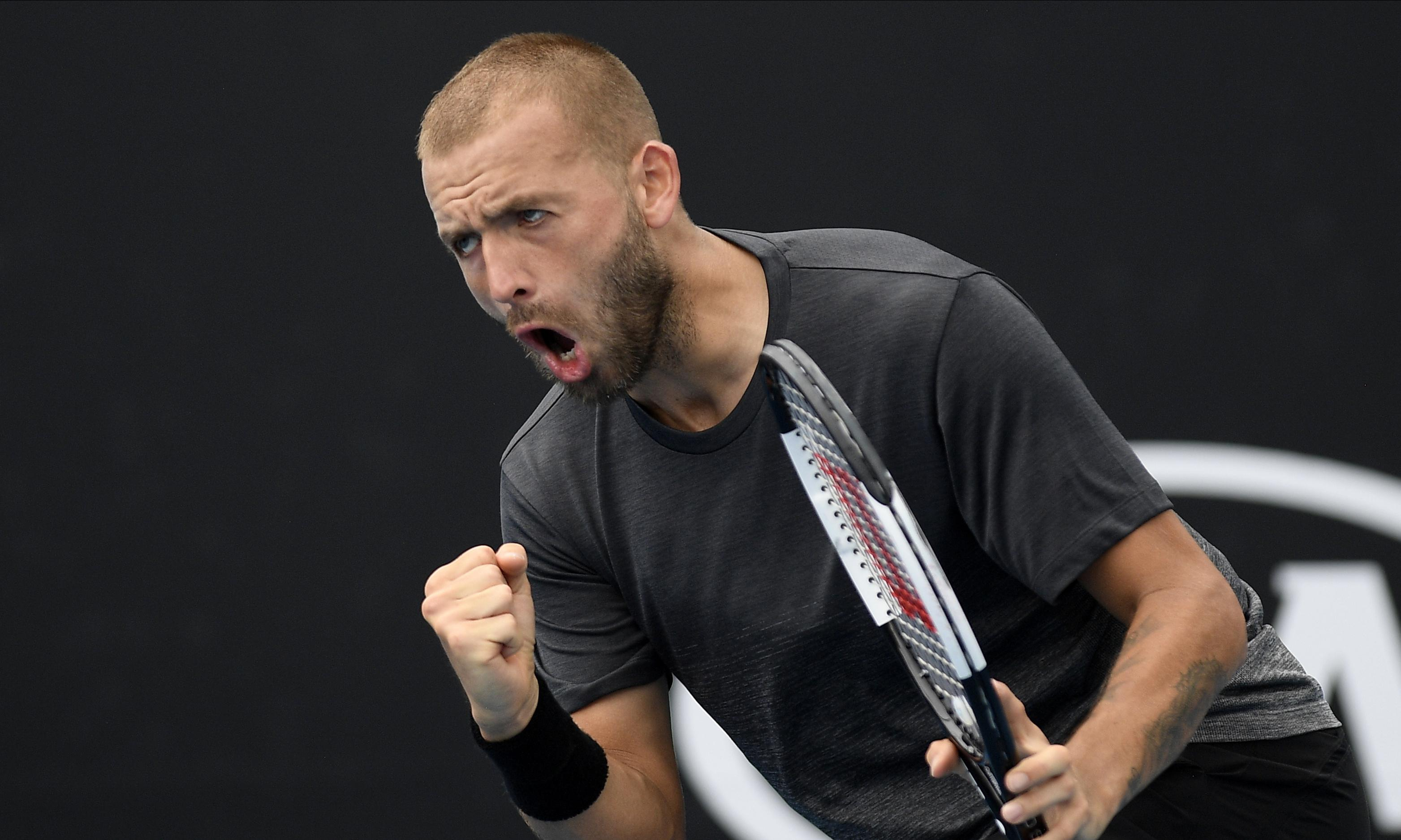 Dan Evans rallies to join Novak Djokovic in Australian Open second round