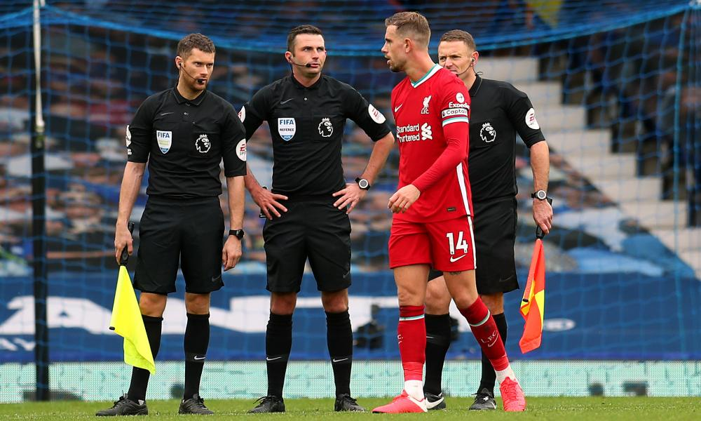 Henderson speaks to referee Michael Oliver