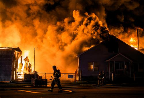 Firefighters tackle a blaze at a timberyard in Lemoyne, Pennsylvania
