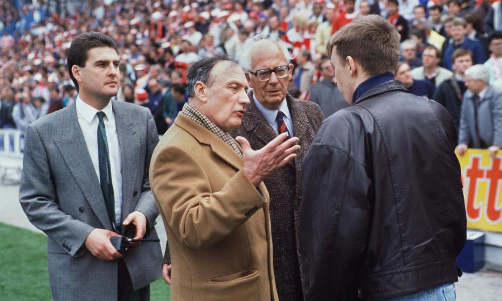 Graham Mackrell, left, looks on as the Liverpool chairman, John Smith, talks to a fan at Hillsborough.