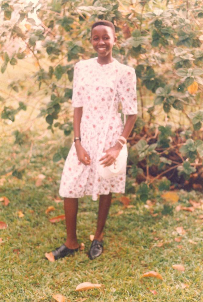 Imbolo Mbue in Limbe in the mid-90s with short hair