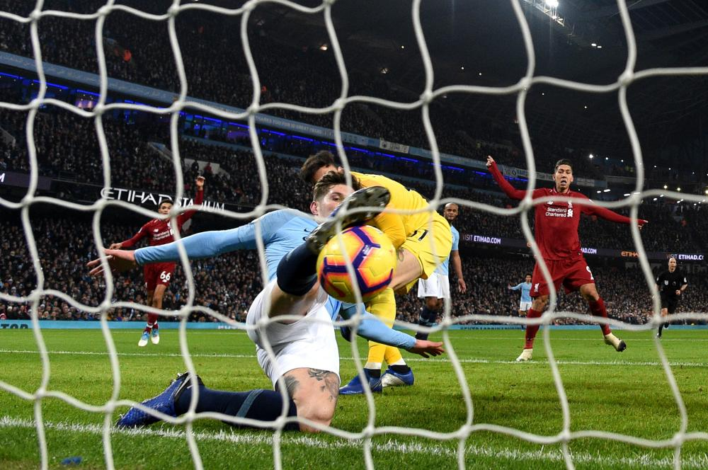 January 3: John Stones of Manchester City makes a goal-line clearance against Liverpool at the Etihad Stadium.