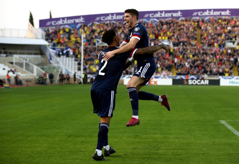 Ryan Christie celebrates with Liam Palmer.