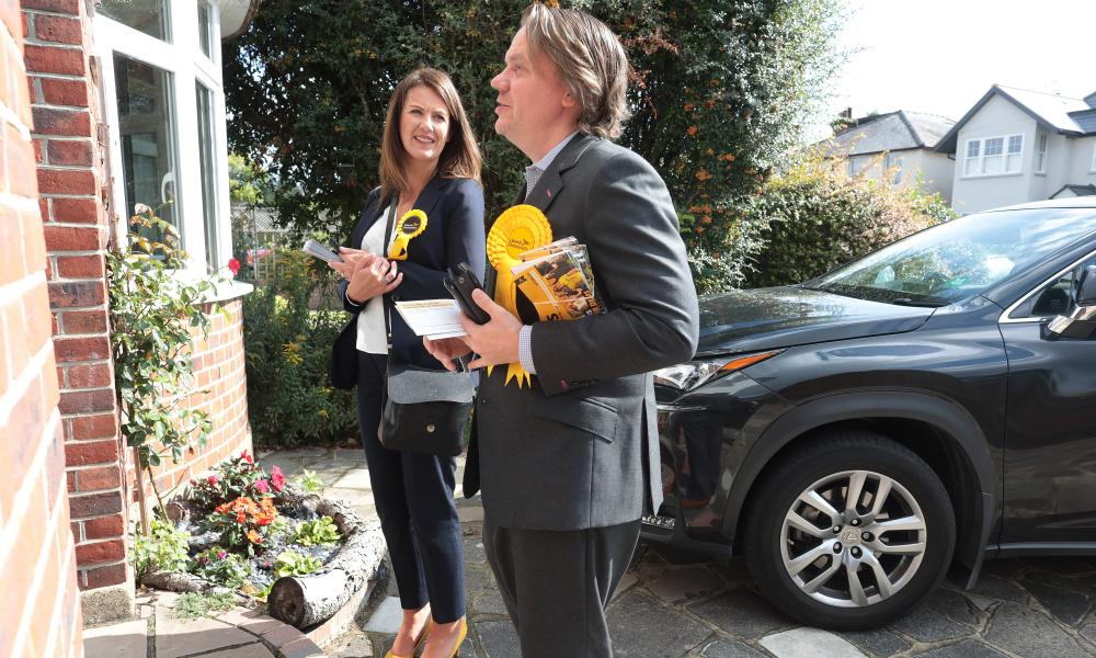 Harding and Robin Stephens, a local councillor, on the streets of Cobham, Surrey.