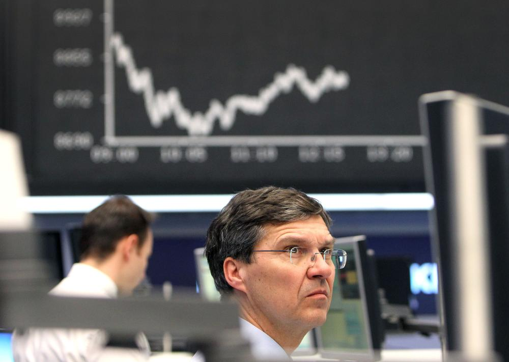 A trader on the Frankfurt stock exchange today