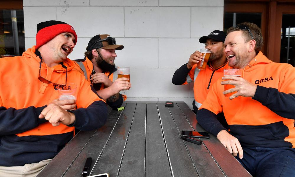 Construction workers have drinks at the end of greater Sydney's Covid lockdown