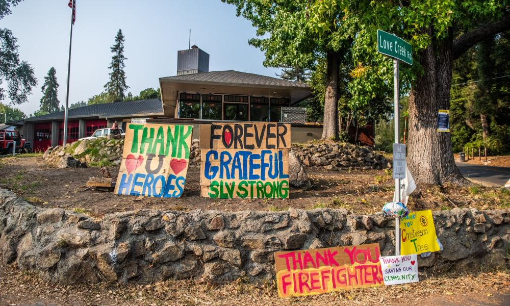 Signs displayed outside the Ben Lomond Volunteer Fire Department in Santa Cruz County, California.