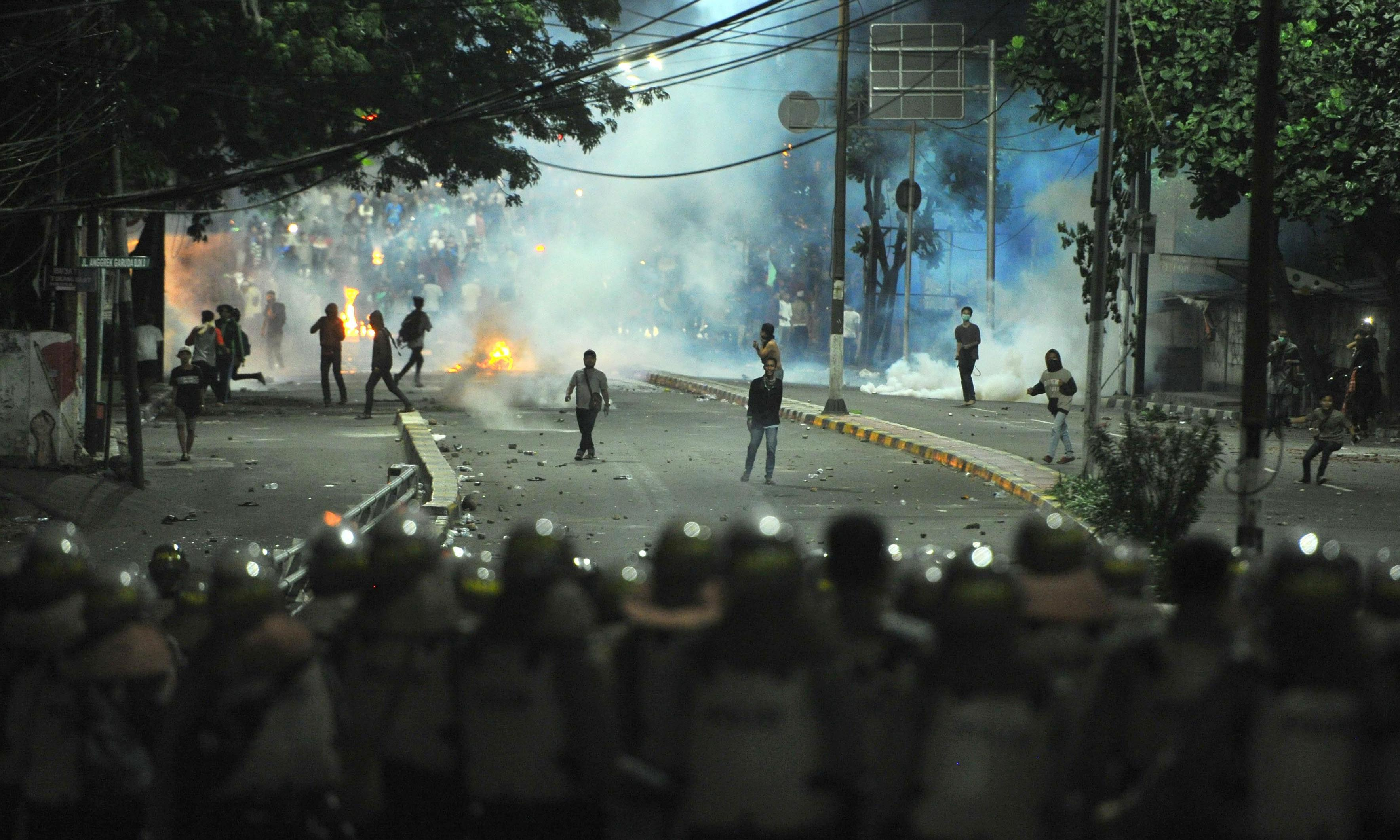 Jakarta riots: Indonesian president says he will not tolerate threats to unity