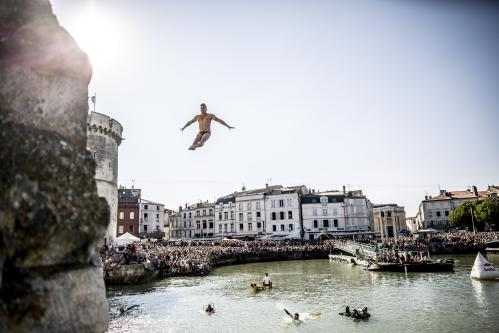 Artem Silchenko of Russia dives from the 27m platform on the Saint Nicolas Tower during the Red Bull Cliff Diving World Series in La Rochelle, France.
