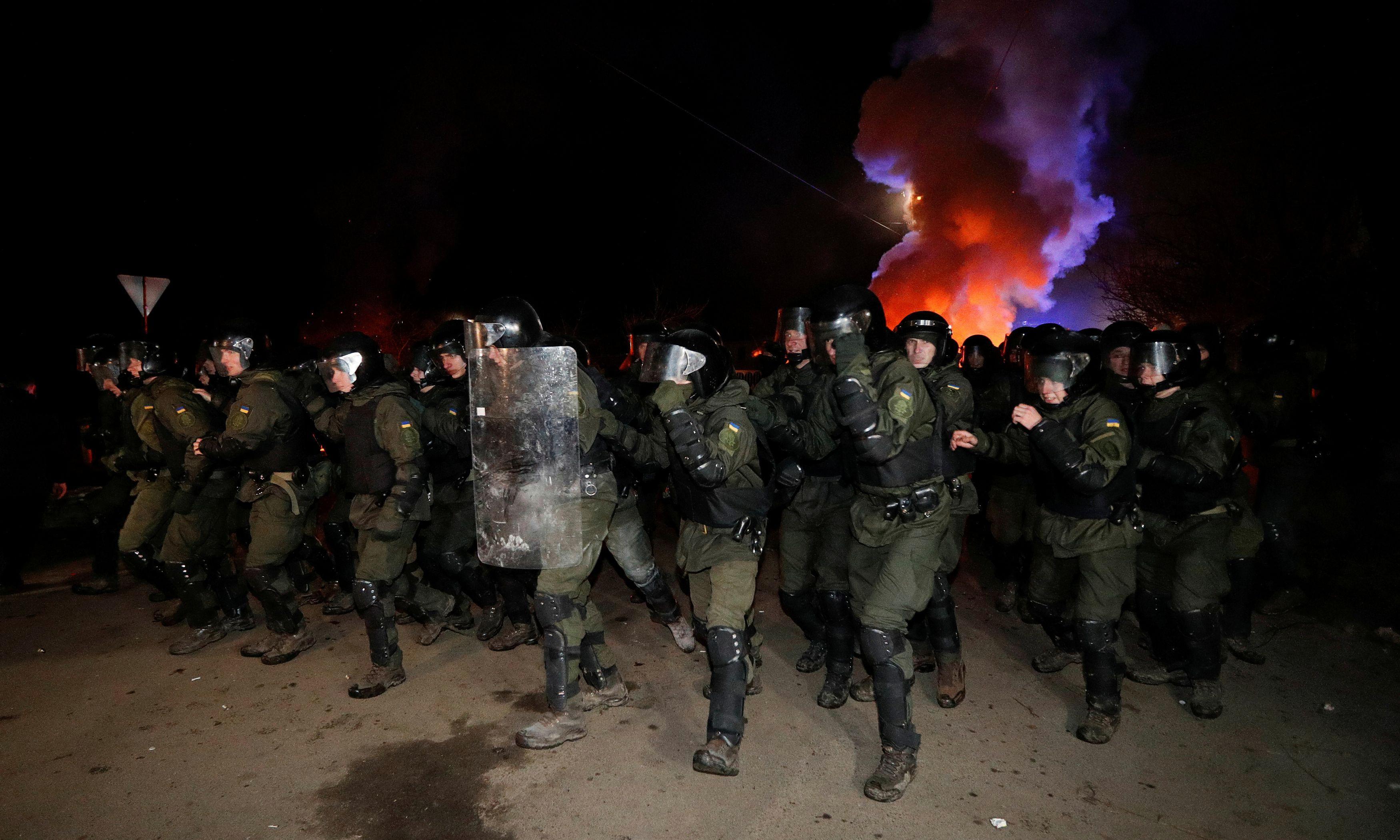 Ukraine: violent clashes as locals hurl stones at coronavirus evacuees' bus