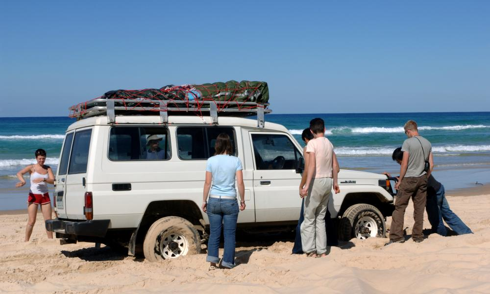 Tourists get their four wheel drive vehicle bogged in the sand on the World Heritage-listed Fraser Island.