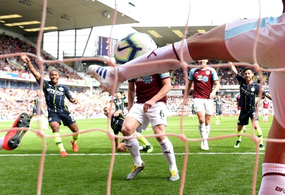 April 28: Matthew Lowton of Burnley fails to keep out an effort by Sergio Aguero of Manchester City.