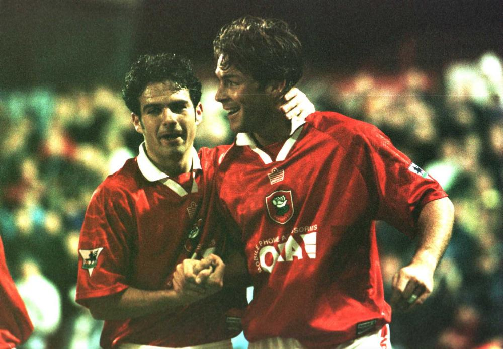 Ashley Ward celebrates with team-mate Nicky Eaden after scoring for Barnsley against Coventry at Oakwell.