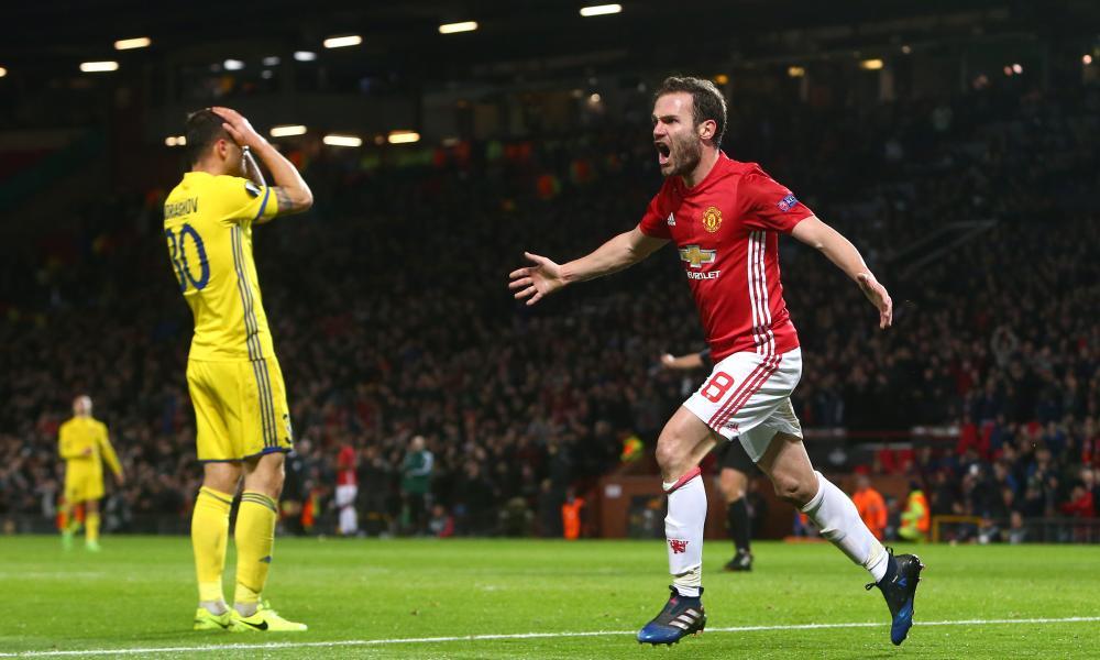 Juan Mata of Manchester United celebrates scoring the opening goal.