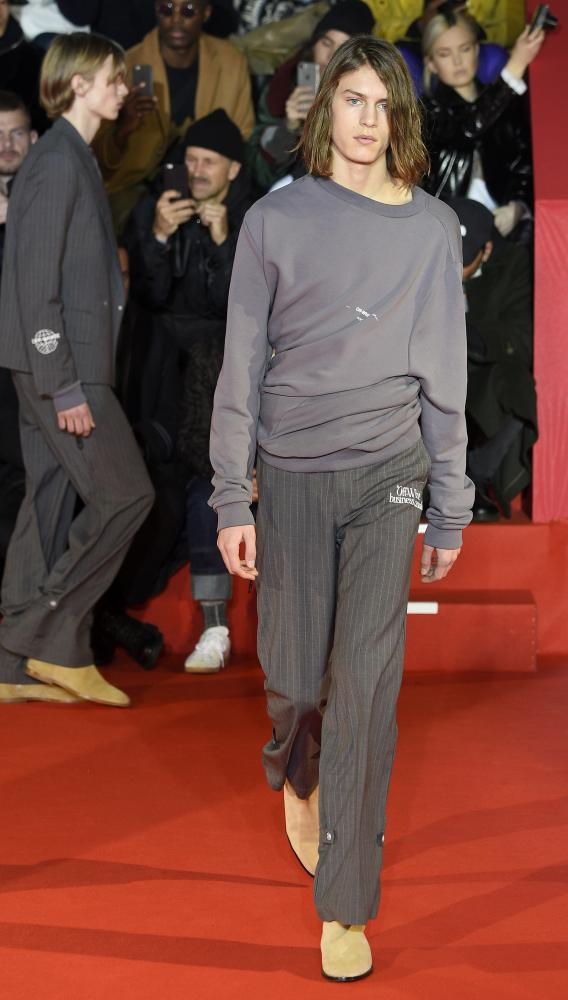 Pinstripe trousers at Off/White's 'Business Casual' presentation, Paris.